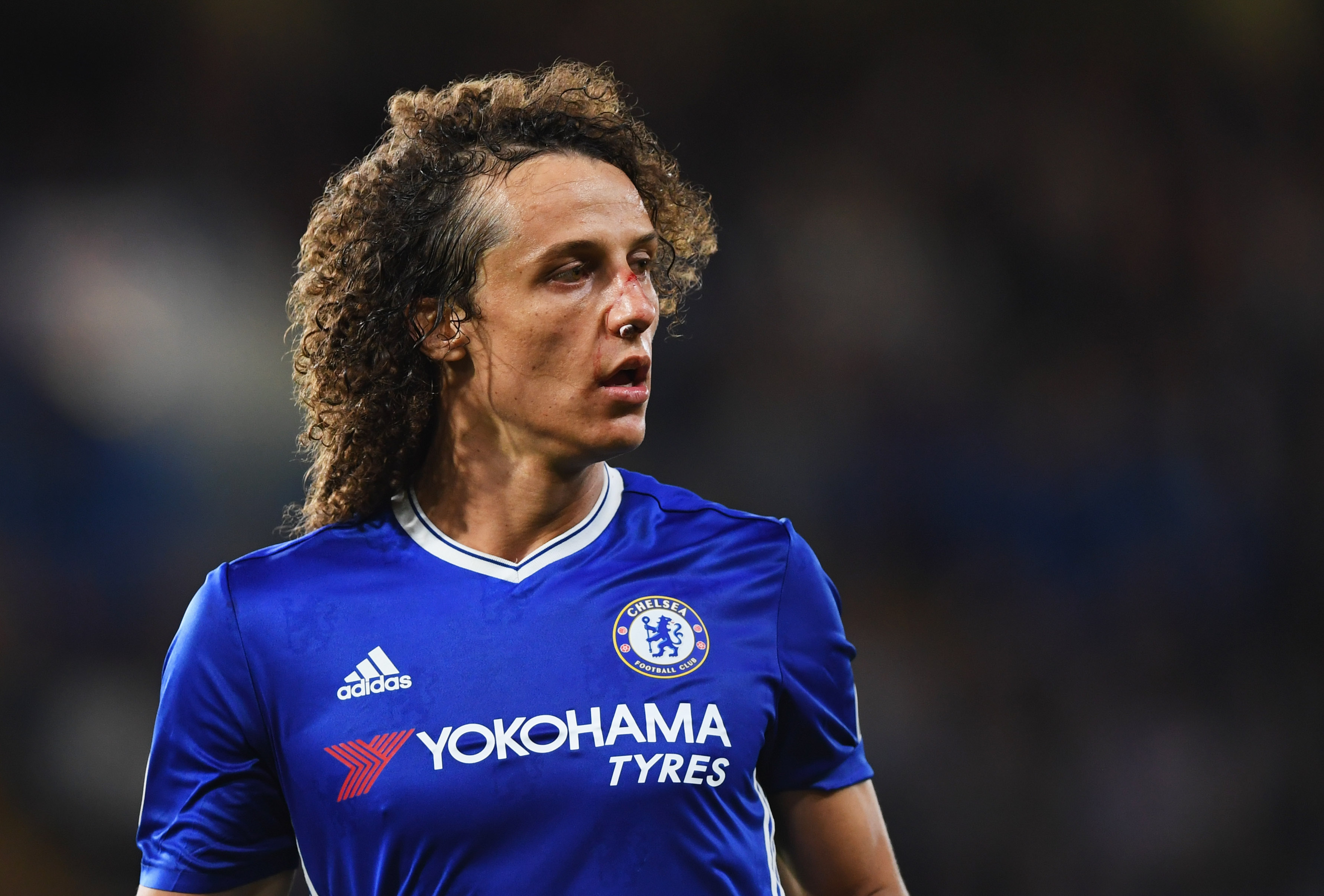 LONDON, ENGLAND - SEPTEMBER 16: A bloody David Luiz of Chelsea looks on during the Premier League match between Chelsea and Liverpool at Stamford Bridge on September 16, 2016 in London, England. (Photo by Shaun Botterill/Getty Images)