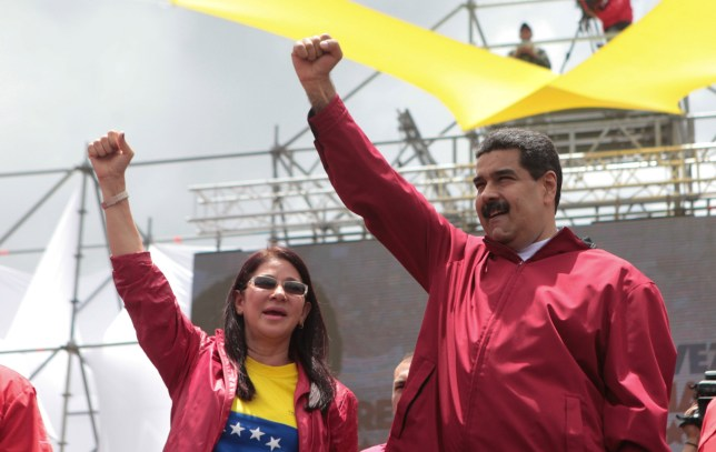 Venezuela's President Nicolas Maduro gestures next to his wife Cilia Flores during a pro-government rally in Caracas, Venezuela September 1, 2016. Miraflores Palace/Handout via REUTERS ATTENTION EDITORS - THIS PICTURE WAS PROVIDED BY A THIRD PARTY. EDITORIAL USE ONLY.