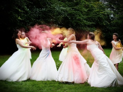 Brides throw paint at each other to trash their wedding dresses