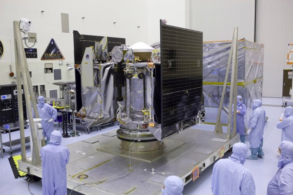 This May 21, 2016 photo provided by NASA shows the OSIRIS-REx spacecraft inside a servicing facility at Kennedy Space Center in Florida after arriving from Lockheed Martin's facility near Denver. Its mission, planned for launch on Thursday, Sept. 8, 2016, aims to return a sample of the asteroid Bennu to Earth for study as well as return detailed information about the asteroid and its trajectory. (Dimitri Gerondidakis/NASA via AP)