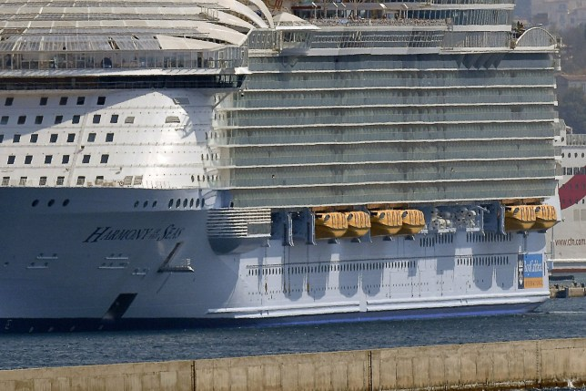 """The world's biggest cruise liner the Harmony of the Seas is docked in the French port of Marseille, southern France, on September 13, 2016. One person was killed and two were seriously injured on September 13 when a lifeboat became detached from the Harmony of the Seas, which was docked in the French port of Marseille, emergency services said. The lifeboat """"became detached"""" from the ship with five people on board, the spokesman said, but there was no immediate confirmation of reports that they had been taking part in a safety drill at the time. / AFP PHOTO / BORIS HORVATBORIS HORVAT/AFP/Getty Images"""