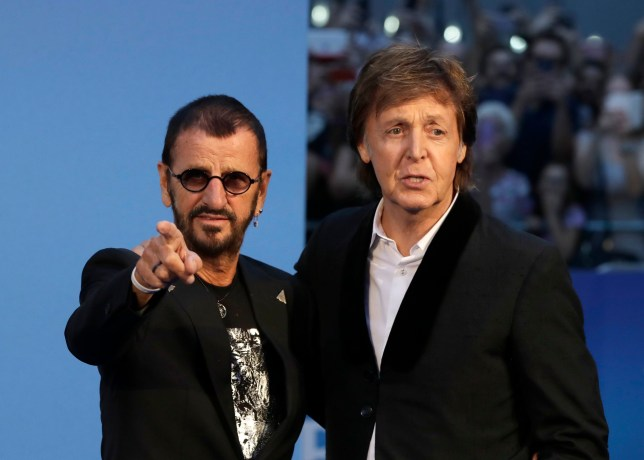 Musicians and members of the Beatles, Paul McCartney, right, and Ringo Starr pose for photographers upon arrival at the World premiere of the Beatles movie, Ron Howard's 'Eight days a week-the touring years' in London, Thursday, Sept. 15, 2016. (AP Photo/Kirsty Wigglesworth)