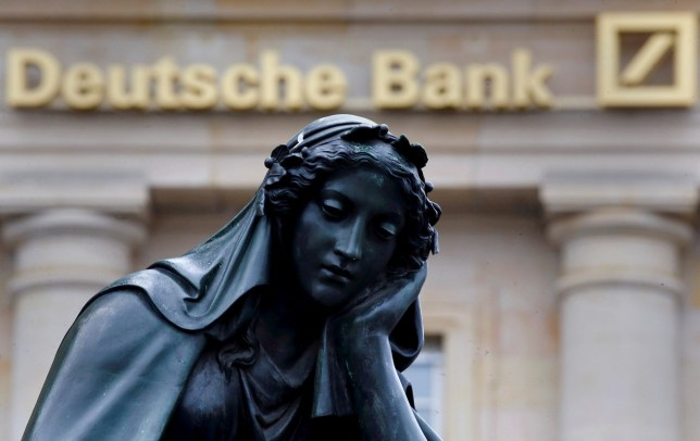A statue is seen next to the logo of Germany's Deutsche Bank in Frankfurt, Germany, January 26, 2016. REUTERS/Kai Pfaffenbach/File Photo