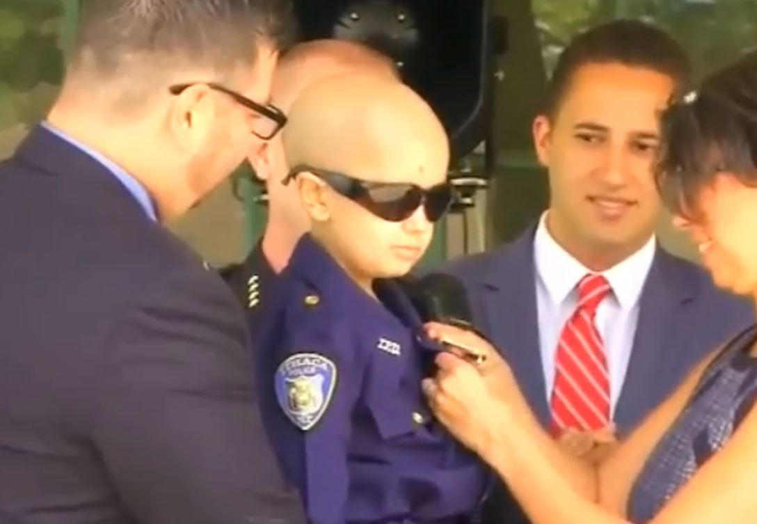 Colin Toland, 9, is now a member of the Ithaca Police Department in New York (Picture: ABC)