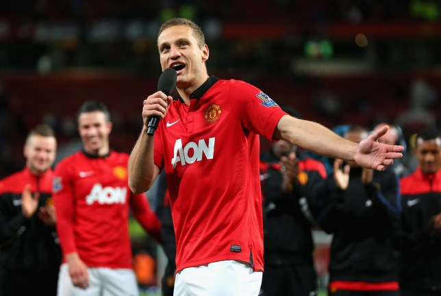 MANCHESTER, ENGLAND - MAY 06: Nemanja Vidic of Manchester United speaks to the fans after his final home game for the club at the end of the Barclays Premier League match between Manchester United and Hull City at Old Trafford on May 6, 2014 in Manchester, England. (Photo by Alex Livesey/Getty Images)
