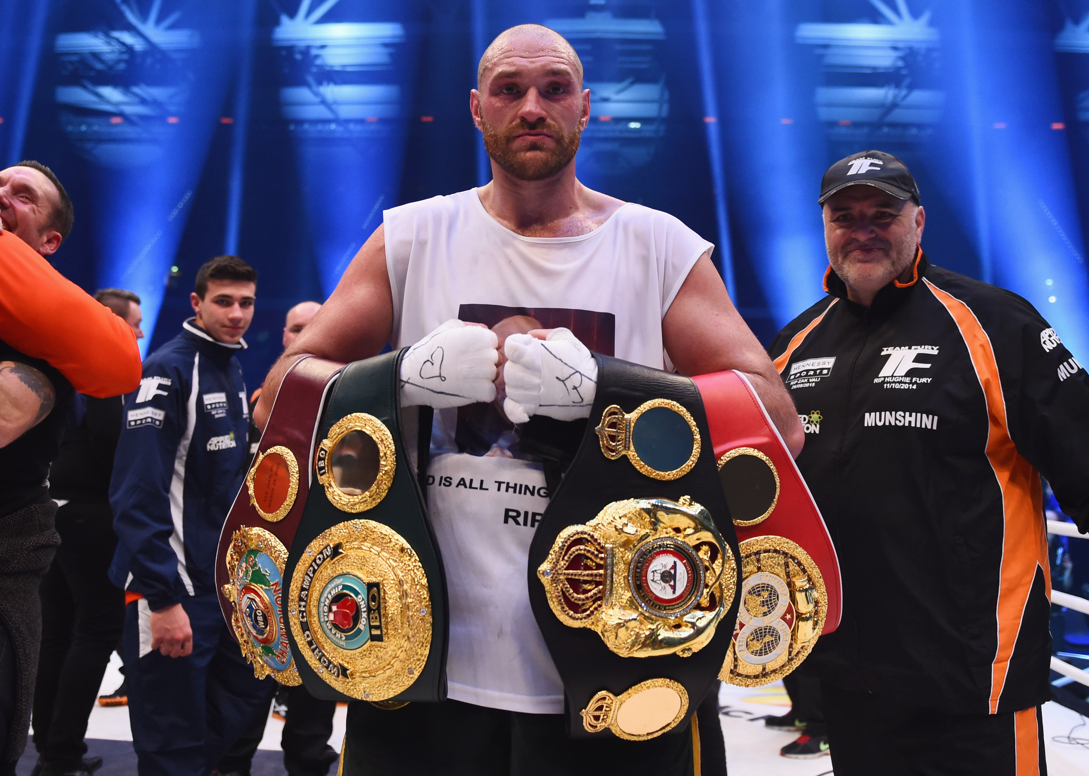 DUESSELDORF, GERMANY - NOVEMBER 28: Tyson Fury celebrates with belts as he defeats Wladimir Klitschko to become new World Heavyweight Champion after the IBF IBO WBA WBO Heavyweight World Championship contest at Esprit-Arena on November 28, 2015 in Duesseldorf, Germany. (Photo by Lars Baron/Bongarts/Getty Images)