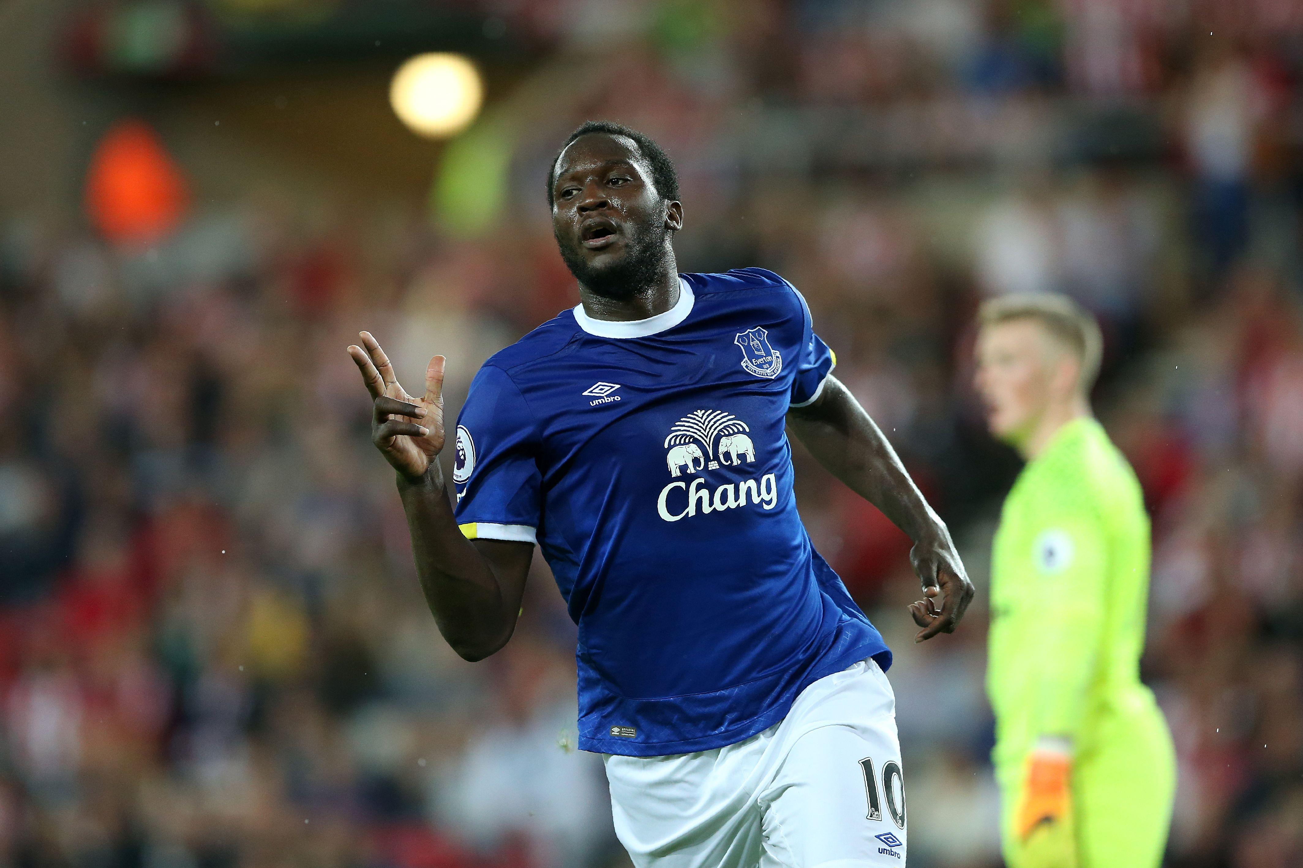 Everton's Belgian striker Romelu Lukaku celebrates scoring his team's third goal during the English Premier League football match between Sunderland and Everton at the Stadium of Light in Sunderland, north-east England on September 12, 2016. / AFP / SCOTT HEPPELL / RESTRICTED TO EDITORIAL USE. No use with unauthorized audio, video, data, fixture lists, club/league logos or 'live' services. Online in-match use limited to 75 images, no video emulation. No use in betting, games or single club/league/player publications. / (Photo credit should read SCOTT HEPPELL/AFP/Getty Images)