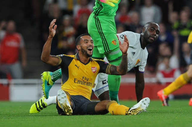 LONDON, ENGLAND - SEPTEMBER 28: Theo Walcott of Arsenal appeals for a penalty as Eder Balanta of Basel looks on during the UEFA Champions League match between Arsenal FC and FC Basel 1893 at Emirates Stadium on September 28, 2016 in London, England. (Photo by David Price/Arsenal FC via Getty Images)