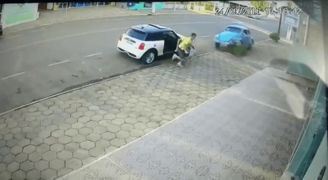Guy cheats death by leaping out of the way of oncoming car Credit: YouTube/Lucas Locatelli