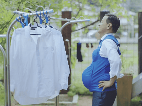 Japanese politicians wear pregnancy vests to urge men to help more at home