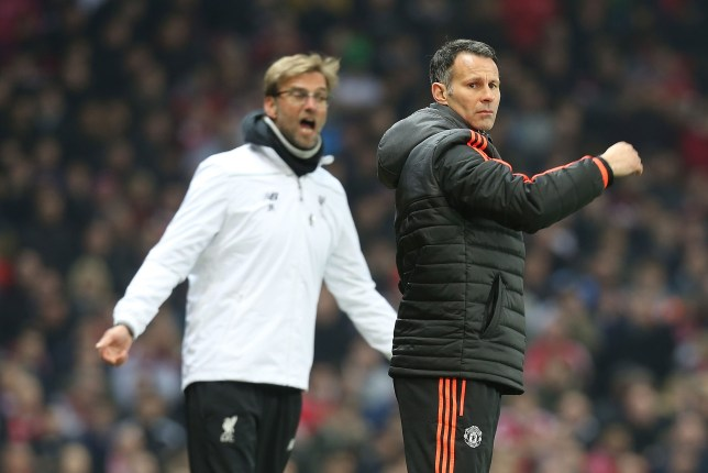 MANCHESTER, ENGLAND - MARCH 17:  Assistant Manager Ryan Giggs of Manchester United and Manager Jurgen Klopp of Liverpool watch from the touchline during the UEFA Europa League Round of 16 Second Leg match between Manchester United and Liverpool at Old Trafford on March 17, 2016 in Manchester, United Kingdom.  (Photo by Matthew Peters/Man Utd via Getty Images)