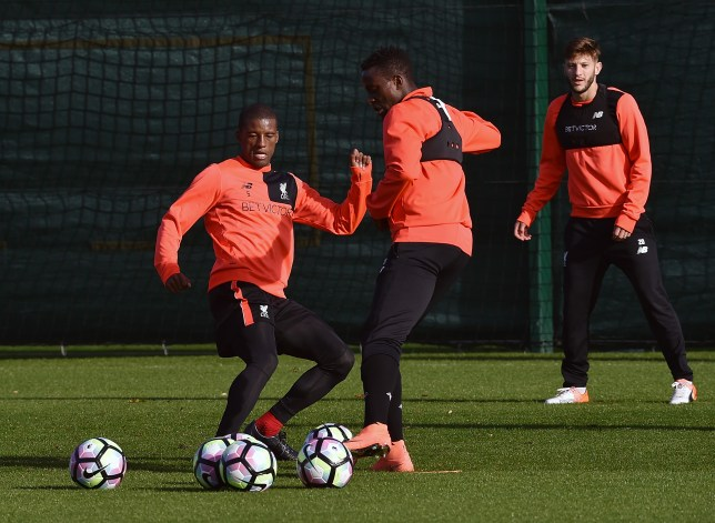 LIVERPOOL, ENGLAND - OCTOBER 19: (THE SUN OUT, THE SUN ON SUNDAY OUT) Georginio Wijnaldum and Divock Origi of Liverpool during a training session at Melwood Training Ground on October 19, 2016 in Liverpool, England. (Photo by Andrew Powell/Liverpool FC via Getty Images)