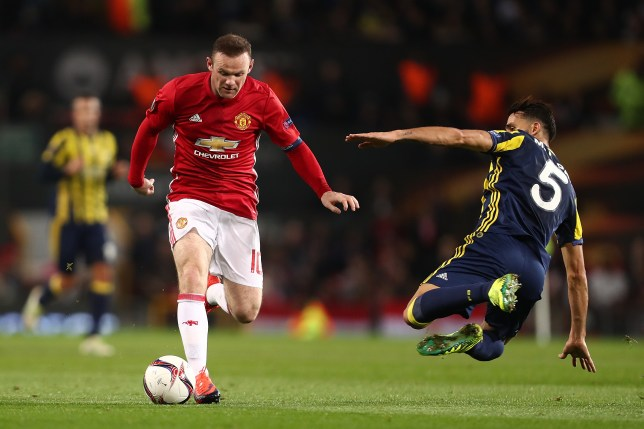 MANCHESTER, ENGLAND - OCTOBER 20: Mehmet Topal of Fenerbahce challenges Wayne Rooney of Manchster United during the UEFA Europa League match between Manchester United FC and Fenerbahce SK at Old Trafford on October 20, 2016 in Manchester, England. (Photo by James Baylis - AMA/Getty Images)