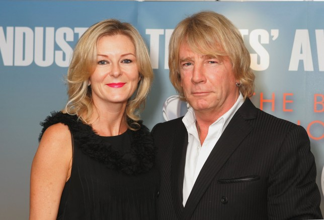 Rick Parfitt of Status Quo and Lyndsay Whitburn at the Music Industry Trust Awards 2006 at the Grosvenor House on October 30, 2006 in London... Suzan/EMPICS Entertainment