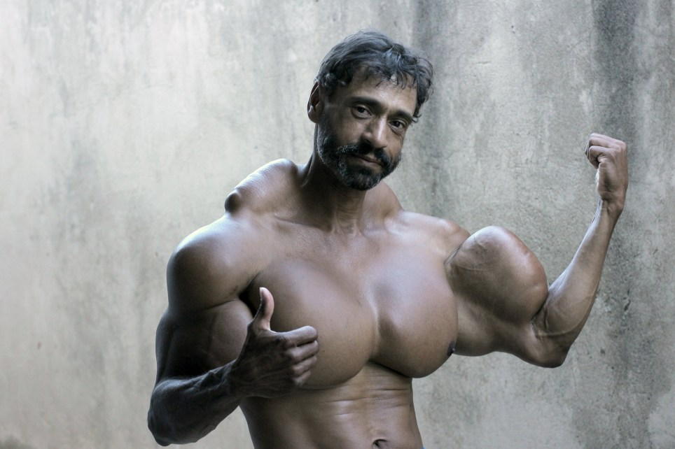 *** EXCLUSIVE - VIDEO AVAILABLE *** SAO PAULO, BRAZIL - SEPTEMBER 18: Valdir shows off his muscles on September 18, 2015, in Sao Paulo, Brazil. An incredible Hulk-inspired bodybuilder is risking his life to pump up his muscles by injecting oil into his arms. Beefcake Valdir Segatoís huge biceps measure a staggering 23 inches as a result of painful synthol injections.The 48-year-oldís arms have doubled in size from 12in after he began injecting the potentially lethal oil substance five years ago - and now he wants to get even bigger. Valdir, from Sao Paulo, Brazil, is inspired by the physiques of Arnold Schwarzenegger and the Hulk and is proud to be known locally as ëHe-Maní and 'the monsterí in the street. PHOTOGRAPH BY Guilherme LaMotta / Barcroft Images London-T:+44 207 033 1031 E:hello@barcroftmedia.com - New York-T:+1 212 796 2458 E:hello@barcroftusa.com - New Delhi-T:+91 11 4053 2429 E:hello@barcroftindia.com www.barcroftimages.com