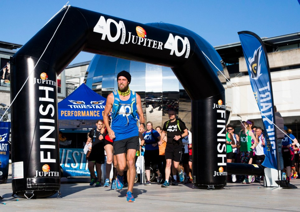 Runner Ben Smith embarks on his 401st Marathon in 401 days, a feat he set out to complete last year that has spanned the UK. Setting off from Millenium Square in Bristol, Ben was joined by 350 other runners in support of his final run. October 5 2016. See SWNS story SWRUN; A real-life Forrest Gump will today (Weds) complete the epic challenge of running 401 marathons in 401 days. British adventurer Ben Smith will complete his final run in Bristol, taking his total number of miles to 10,506.2 - the equivalent distance of London to Sydney. Since setting off on September 1st last year, he has worn through 22 pairs of trainers, lost 19kg in weight and battled injuries including a fractured vertebrae in his spine. He has completed the extraordinary journey around the UK to increase awareness of bullying, and aims to raise £250,000 for the anti-bullying charity Kidscape and the LGBT-rights charity Stonewall.