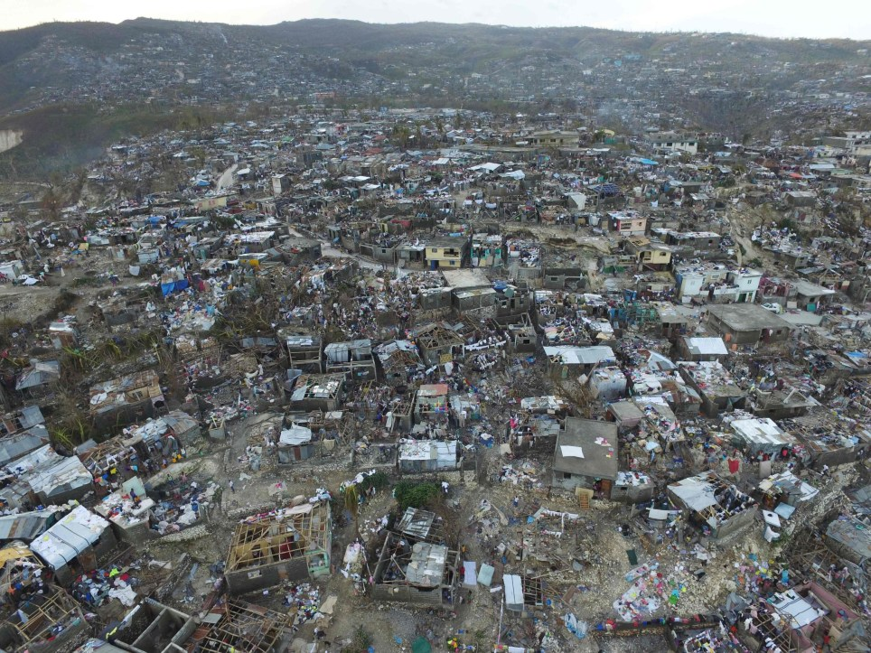 TOPSHOT - Homes destroyed and damaged by Hurricane Matthew are seen in Jeremie, in western Haiti, on October 7, 2016. The full scale of the devastation in hurricane-hit rural Haiti became clear as the death toll surged over 400, three days after Hurricane Matthew leveled huge swaths of the country's south. / AFP PHOTO / Nicolas GARCIANICOLAS GARCIA/AFP/Getty Images