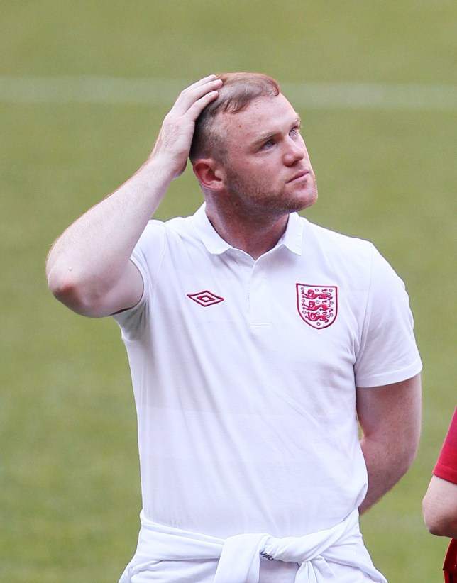 Englands Wayne Rooney holds his hair..Euro 2012 England training, Donbass Arena, Donetsk, 18th June 2012.