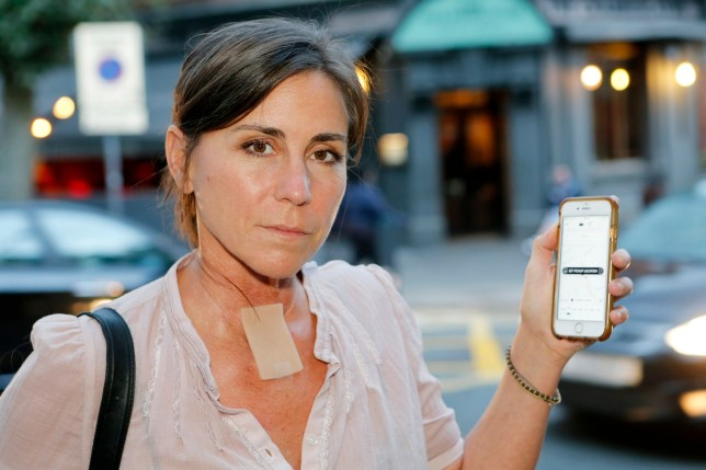 PIC BY JASON MITCHELL/MERCURY PRESS (PICTURED: SAM BARBIC, 45 WITH THE UBER APP) A cancer survivor whose illness left her with a speech impediment and a hole in her neck claims an Uber driver dragged her out of his cab because she ëwasnít talking properlyí ñ then charged her a fiver for a cancelled journey. Sam Barbic said the driver screamed at her and grabbed her arm to pull her from his vehicle outside her home in London. The 45-year-old said she was left ëbaffledí and ëhorrifiedí by the experience, which Uber has pledged to investigate. Sam was diagnosed with oesophageal cancer five years ago and had her entire throat removed and replaced with parts of her intestine. The operation ñ a laryngectomy ñ saw her voice box removed, meaning she now speaks softly, with long pauses, by pressing against the hole in her airway. SEE MERCURY COPY