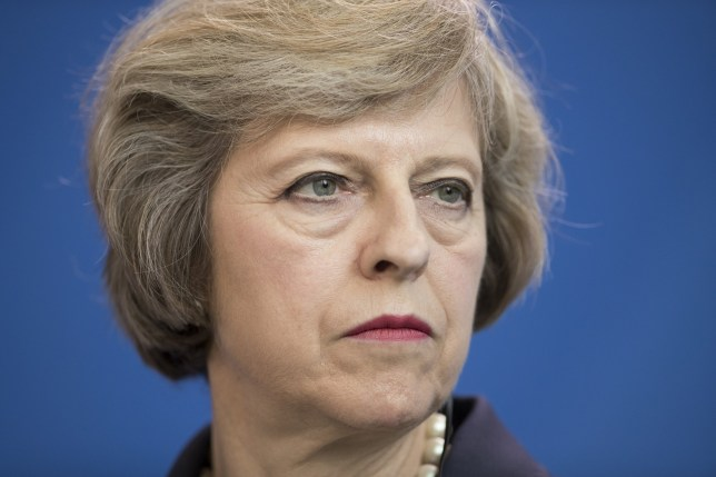 Theresa May, U.K. prime minister, looks on during a news conference with Angela Merkel, Germany's Chancellor, not pictured, at the Chancellery in Berlin, Germany, on Wednesday, July 20, 2016. Merkel, who hosted May in Berlin on Wednesday during her first overseas trip as prime minister, said that EU rules stipulate a country must invoke Article 50 to start the process of leaving the 28-nation bloc. Photographer: Jasper Juinen/Bloomberg via Getty Images