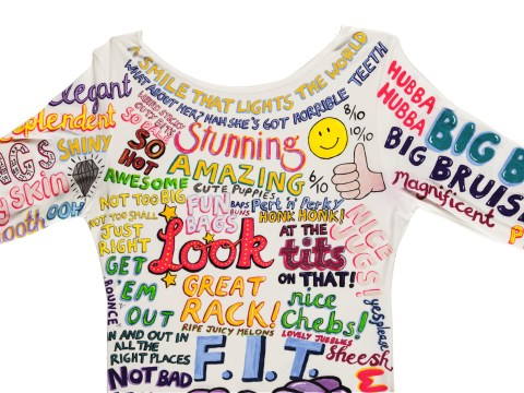 A woman has painted a dress with all the things people have said about her appearance