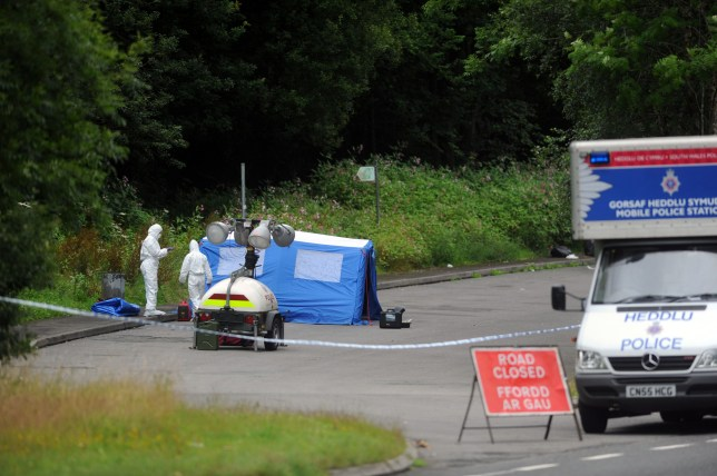 Forensic teams and a tent work in a lay by after an alleged car chase and shooting near, Abercynon, on A4059. - TWO brothers shot a drug dealing taxman at the side of a road, a court has heard.nStephen Bennett, 53, and Edward Bennett, 47, are accused of murdering Mark Jones, who worked as a valuation officer for the HMRC and who, the court was told, sold drugs.nThe 43-year-old was found with gunshot wounds in a lay-by on the A4059 in Mountain Ash on July 26 last year.nHe died in hospital on September 26, 2015, after 15 operations on his wounds having allegedly been shot twice.nStephen Bennett, of Masefield Way, Pontypridd, and brother Edward, of Station Terrace, Penrhiwceiber, both deny murdering father-of-one Mr Jones, from Mountain Ash.nProsecutor Christopher Clee QC began the opening at Cardiff Crown Court yesterday, in front of a jury of eight men and four women.n