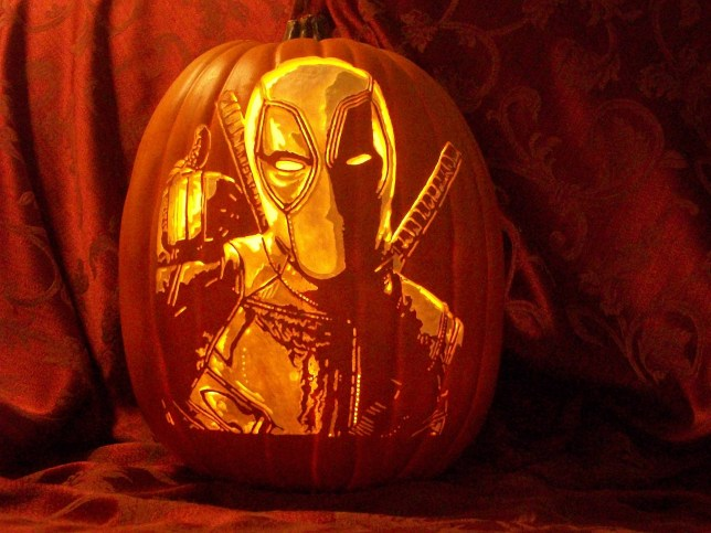 Pic by HotSpot Media - ARTIST CREATES INCREDIBLE PUMPKIN CARVINGS USING A DRILL - IN PIC - A Halloween pumpkin carved to display Marvel character Deadpool. - An artist has carved intricately detailed portraits of famous pop-culture faces into artificial pumpkins using a drill. From Star Wars and The Walking Dead characters to The Little Mermaid's Ariel and Harry Potter, no design is too complicated for award-winning artist Alex J Wer, 49, of Sacramento, California. The father-of-two spends up to four hours working on each pumpkin, which are made from polyurethane foam, using different drill bits to carefully carve the characters into the surface...SEE HOTSPOT MEDIA COPY 0121 551 1004