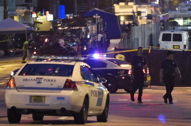 Lights from police vehicles light up the scene infront of the Pulse club in Orlando, Florida on June 12, 2016. nFifty people died when a gunman allegedly inspired by the Islamic State group opened fire inside a gay nightclub in Florida, in the worst terror attack on US soil since September 11, 2001. / AFP / Mandel Ngan (Photo credit should read MANDEL NGAN/AFP/Getty Images) pulse nightclub