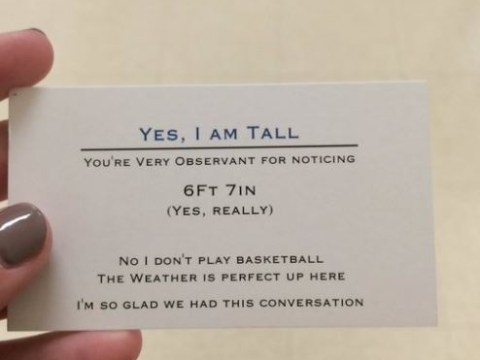 Tall teen has business cards he hands out to stop people asking about his height