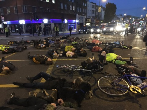 Cyclists hold 'die-in' at junction where pedestrian was hit by cement mixer