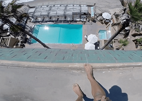 Man jumps off five-storey building into a swimming pool