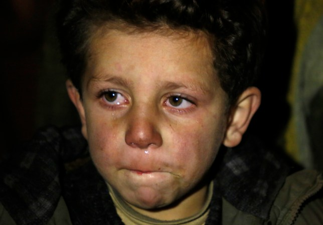 A young boy waits to be evacuated from the besieged town of Madaya, northwest of Damascus, Syria. Aid convoys reached three besieged villages on Monday - Madaya, near Damascus, where U.N. humanitarian chief Stephen O'Brien said about 400 people need to be evacuated immediately to receive life-saving treatment for medical conditions, malnourishment and starvation, and the Shiite villages of Foua and Kfarya in northern Syria. Reports of starvation and images of emaciated children have raised global concerns and underscored the urgency for new peace talks that the U.N. is hoping to host in Geneva on January 25. In this Monday, January 11, 2016 photo. (AP Photo)