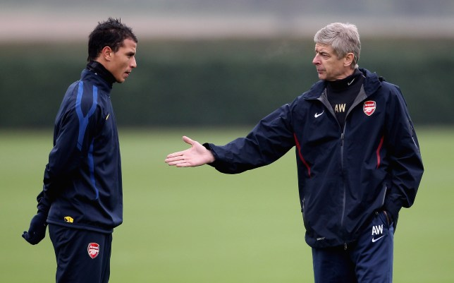 ST ALBANS, ENGLAND - NOVEMBER 22:  Arsenal manager Arsene Wenger talks to Marouane Chamakh during Arsenal training ahead of their UEFA Champions League match against Braga at London Colney on November 22, 2010 in St Albans, England.  (Photo by Scott Heavey/Getty Images)