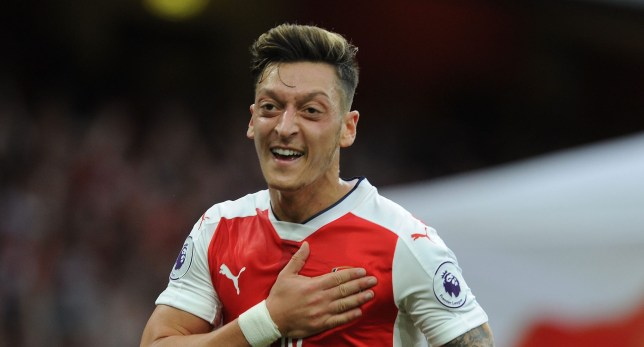LONDON, ENGLAND - SEPTEMBER 24: Mesut Ozil celebrates scoring Arsenal's 3rd goal during the Premier League match between Arsenal and Chelsea at Emirates Stadium on September 24, 2016 in London, England. (Photo by David Price/Arsenal FC via Getty Images)