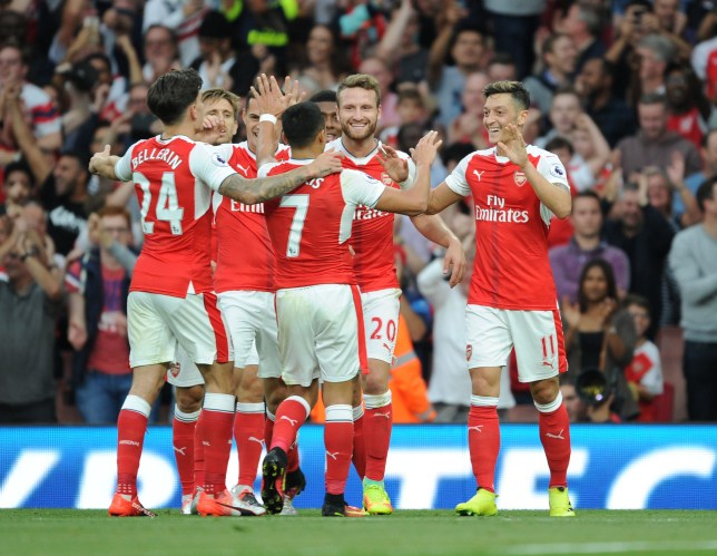 LONDON, ENGLAND - SEPTEMBER 24: (R) Mesut Ozil celebrates scoring the 3rd Arsenal goal with (L) Hector Bellerin, (2ndL) Alexis Sanhez and (3rdL) Shkodran Mustafi during the Premier League match between Arsenal and Chelsea at Emirates Stadium on September 24, 2016 in London, England. (Photo by Stuart MacFarlane/Arsenal FC via Getty Images)