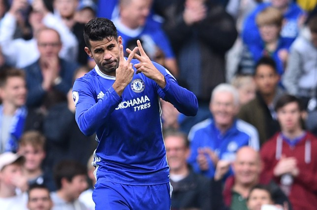 Chelsea's Brazilian-born Spanish striker Diego Costa celebrates with a gesture in support of Willian, who's mother passed away recently, after scoring the opening goal of the English Premier League football match between Chelsea and Leicester City at Stamford Bridge in London on October 15, 2016. / AFP / Glyn KIRK / RESTRICTED TO EDITORIAL USE. No use with unauthorized audio, video, data, fixture lists, club/league logos or 'live' services. Online in-match use limited to 75 images, no video emulation. No use in betting, games or single club/league/player publications. / (Photo credit should read GLYN KIRK/AFP/Getty Images)