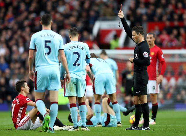 MANCHESTER, ENGLAND - OCTOBER 29: Ander Herrera (1st L) of Manchester United is shown the red card by referee Mark Clattenburg (2nd R) after the second yellow card during the Premier League match between Manchester United and Burnley at Old Trafford on October 29, 2016 in Manchester, England. (Photo by Mark Robinson/Getty Images)