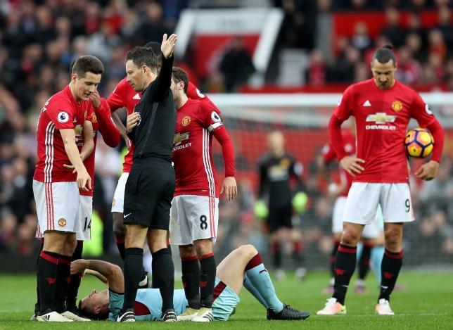 MANCHESTER, ENGLAND - OCTOBER 29: Ander Herrera of Manchester United protests to referee Mark Clattenburg (2nd R) after the red card during the Premier League match between Manchester United and Burnley at Old Trafford on October 29, 2016 in Manchester, England. (Photo by Mark Robinson/Getty Images)