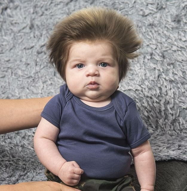 This baby's bouffant hair is so attention-grabbing, it takes his mum two hours to do the weekly shop
