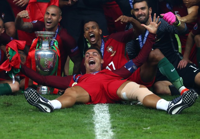 PARIS, FRANCE - JULY 10: Cristiano Ronaldo and Portugal players celebrate after their 1-0 win against France in the UEFA EURO 2016 Final match between Portugal and France at Stade de France on July 10, 2016 in Paris, France. (Photo by Lars Baron/Getty Images)