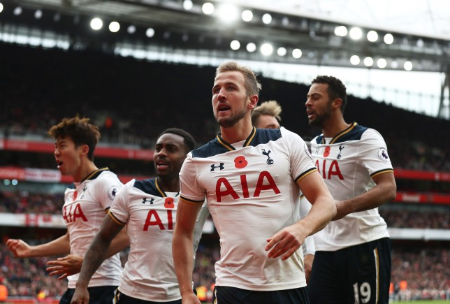 LONDON, ENGLAND - NOVEMBER 06: Harry Kane of Tottenham Hotspur celebrates scoring his sides first goal with team mates during the Premier League match between Arsenal and Tottenham Hotspur at Emirates Stadium on November 6, 2016 in London, England. (Photo by Clive Rose/Getty Images)