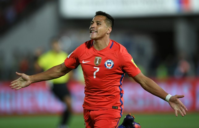 Chile's forward Alexis Sanchez celebrates after scoring against Uruguay during their 2018 FIFA World Cup qualifier football match in Santiago, on November 15, 2016. / AFP / Martin BERNETTI        (Photo credit should read MARTIN BERNETTI/AFP/Getty Images)