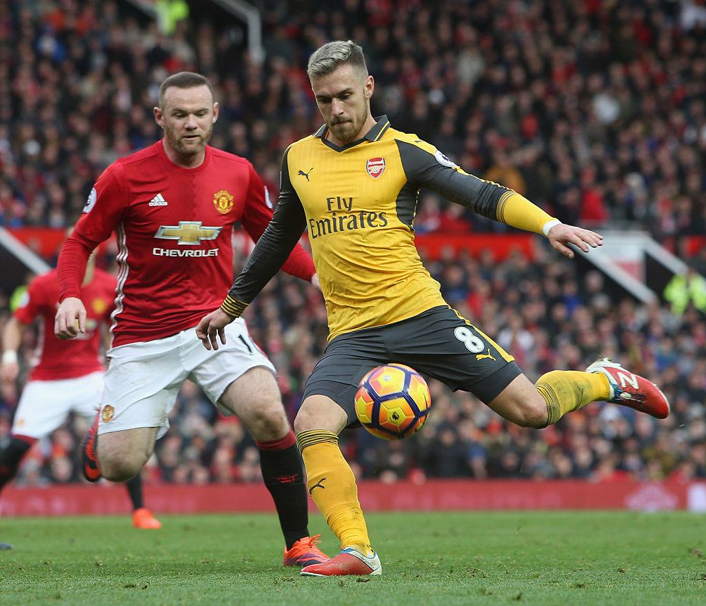 Arsenal stars Aaron Ramsey and Theo Walcott skip training ahead of PSG clash as a precaution
