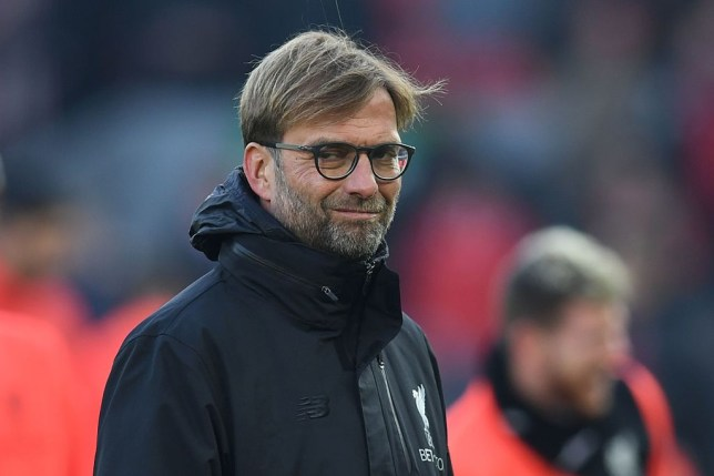 Liverpool's German manager Jurgen Klopp stands on the pitch during the warm up ahead of the English Premier League football match between Liverpool and Sunderland at Anfield in Liverpool, north west England on November 26, 2016. / AFP / Paul ELLIS / RESTRICTED TO EDITORIAL USE. No use with unauthorized audio, video, data, fixture lists, club/league logos or 'live' services. Online in-match use limited to 75 images, no video emulation. No use in betting, games or single club/league/player publications. / (Photo credit should read PAUL ELLIS/AFP/Getty Images)