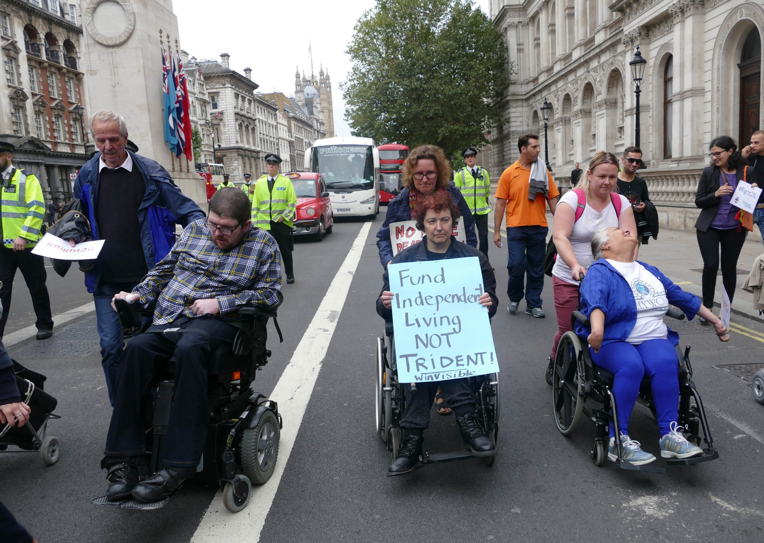 Disabled People Against Cuts (DPAC) performed a Street Theatre demonstration in front of Number 10 Downing Street in London, England, on September 6, 2016. The group paid homage to Independent living using poetry and singing drawing attention to the effects the Austerity cuts have had on their Independent living. They used the hashtag #Right2IL to garner support and recognition on Social Media. (Photo by Gail Orenstein/NurPhoto via Getty Images)