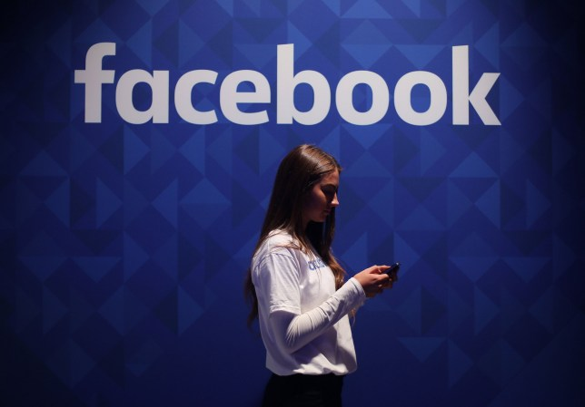 File photo dated 03/11/15 of a woman using her phone under a Facebook logo, as insurer Admiral announced that first-time drivers can receive reduced insurance quotes by allowing their Facebook profiles to be scoured in a bid to determine their personalities. PRESS ASSOCIATION Photo. Issue date: Wednesday November 2, 2016. The insurance company said that those buying their first car could join the optional scheme to receive a discount of up to 15%. See PA story TRANSPORT Facebook. Photo credit should read: Niall Carson/PA Wire