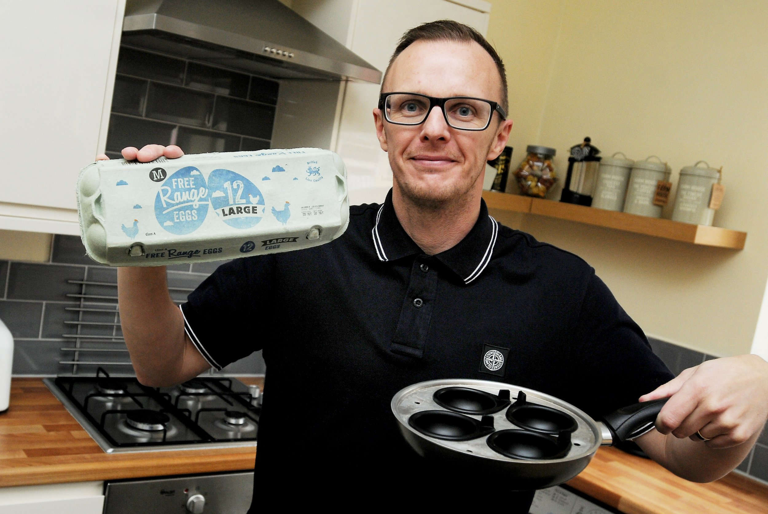 """John Landy who cracked 10 double-egg yolks from the same box, it's thought that one double egg-yolk is very rare, 1,000 to one. A family man beat huge odds when he cracked open TEN eggs only to find they all had DOUBLE YOLKS. See ROSS PARRY story RPYEGGS. John Landy, 40, was totally gobmsacked when he cracked one egg, then another and another until he finished the box and realsied they were all rare double yolkers. The odds of finding ONE of the these scarce eggs is said to be 1,000 to one, so the odds on finding ten - in a row will be staggering. Dad-of-two John, said: """"When I got one double yolk, I was quite surprised because I had never see one before."""