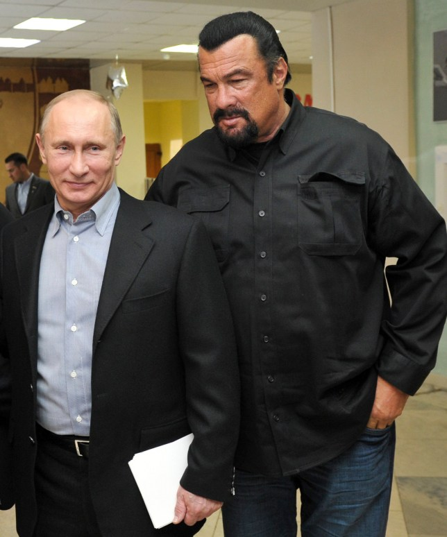 FILE - In this file photo taken on Wednesday, March 13, 2013, Russian President Vladimir Putin, left, and U.S. movie actor Steven Seagal visit a new sports arena in Moscow, Russia. file photo, Russian President Vladimir Putin, right, speaks with U.S. actor Steven Seagal in the Russian Far Eastern port of Vladivostok. Russian President Vladimir Putin has awarded Russian citizenship to action film actor Steven Seagal, the Kremlin said Thursday. Nov. 3, 2016. øThe 64-year-old Seagal has been a regular visitor to Russia in recent years and has accompanied Putin to several martial arts events, as well as vocally defending the Russian leader's policies and criticizing the U.S. government. (Alexei Nikolsky/Sputnik, Kremlin File Pool Photo via AP, File)