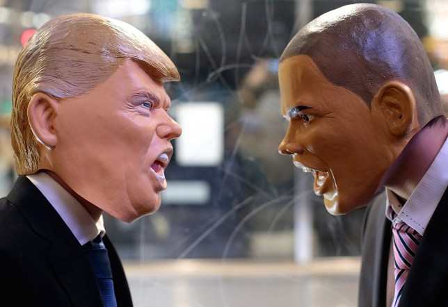 TOKYO, JAPAN - OCTOBER 31: Participants in costume of U.S. President Barack Obama (R) and Republican presidential nominee Donald Trump pose to look at each other for a photograph during Halloween celebration at Shibuya district on October 31, 2016 in Tokyo, Japan. (Photo by Yuya Shino/Getty Images)