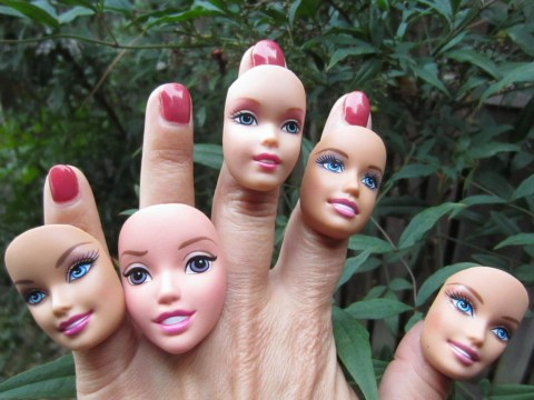 The next big trend is wearing Barbie's decapitated head on your fingers